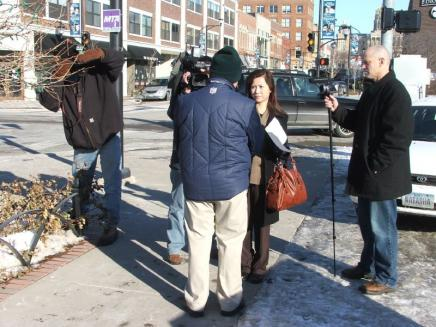 Roger Routh on the sidewalk with an international news organization