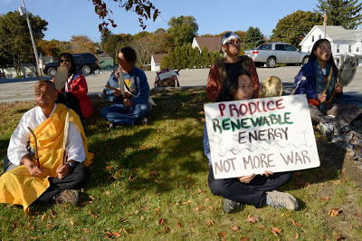 Drumming and chanting outside Bath Iron Works (BIW) while waiting for workers to get off work