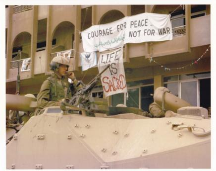 U.S. Marines occupy Baghdad, in March 2003, in front of the Al Fanar hotel that housed Voices activists throughout the Shock and Awe bombing.
