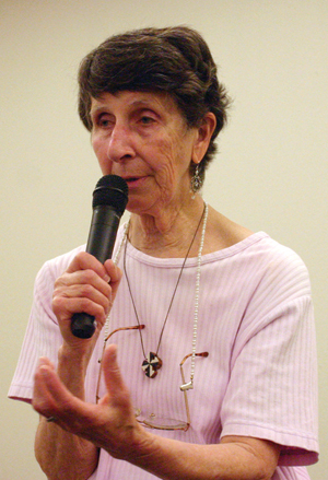 "Sister Pat Chaffee, OP, speaks at the Congregation of the Humility of Mary motherhouse in Davenport June 9. She and other peace advocates criticized overseas drone strikes in advance of a march, ""Covering Ground to Ground the Drones."""