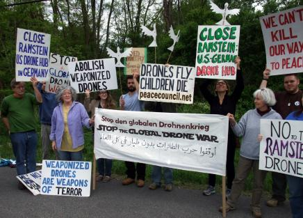Members of the upstate Drone Action Coalition outside the Hancock Air Force base, New York: Ed Kinane is on the far left. Photo Credit: Upstate Drone Action