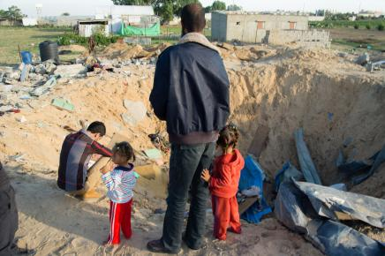 Walid al Nassasra stands next to the former home of his brother near Rafah