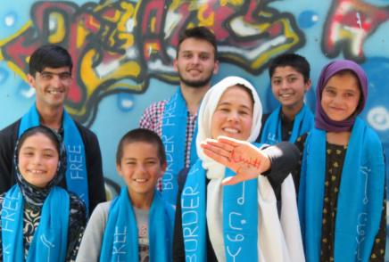 Zarghuna with the word #Enough! in Dari/Pashto on her hand, with friends: from left to right : Mursal, Barath, Inam, Muheb, Zarghuna, Kahar and Zahra
