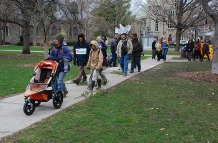 Marchers depart DeWitt Park Sunday afternoon to begin a five-day peace march to Syracuse. The march was organized by Peace Now Ithaca.  RACHEL STERN /