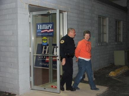 Chris Gaunt, 51 year-old Iowa farmer is led to jail after peacefully occupying Senator Hillary Clinton's Des Moines campaign office to protest her support of the Iraq war.