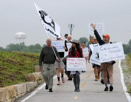 A group of about 20 protesters began a Rock Island to Des Moines march this morning to call attention to the U.S. government's use of drones to kill alleged terrorists. The practice makes more enemies than it eliminates, the group contends.