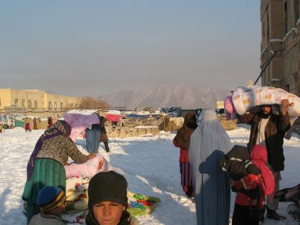 Afghan Peace Volunteers deliver duvets to women at the Darlaman refugee camp in Kabul. photo credt:  Martha Hennessy