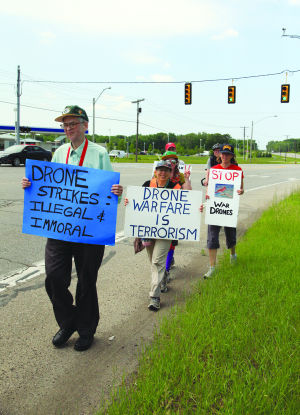 Phil Runkel, left, of Waukesha, Wis., is part of a group walking to protest the use of drones in warfare.: photo by Kristy Noack