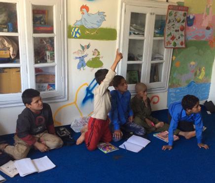 Children in the Street Kids program studying Dari and math.