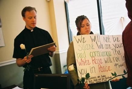 We Will Not Be Silent (photo: Suzanne Sheridan): Chris Spicer, a Jesuit, and Abby Strozinski, student at Loyola University Chicago, in Representative Emanuel's office.