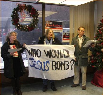 (left to right) Kathy Kelly, Mona Shaw, and Robert Braam were arrested in Huckabee's Des Moines Campaign Headquarters.