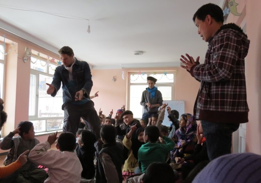 Children at the Afghan Peace Volunteer's Borderfree Street Kid's School learn from Ellis Brooks and Dr. Hakim about resolving conflicts peacefully.