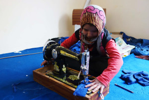 Sakina with sewing machine