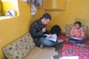 Zek conducting the survey in Zuhair's home