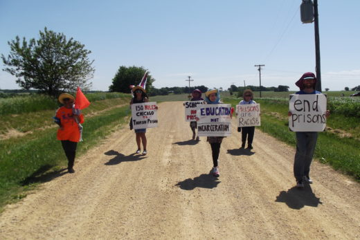 Razia, Maya, Sabia, Kathy, Libby and Buddy participate in a walk from Chicago to Thomson prison