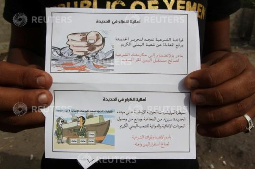 """A man displays leaflets dropped by Saudi-led coalition's air force on the Red Sea port city of Hodeidah, Yemen April 26, 2017. The leaflets read: """"Our forces of legitimacy are heading to liberate Hodeidah and end the suffering of our gracious Yemeni people. Join your legitimate government in favor of the free and happy Yemen!"""" And """"The control of the Hodeidah port by the terrorist Houthi militia will increase famine and hinder the delivery of international relief aid to our gracious Yemeni people. Join our legitimate forces for the sake of the stability of Yemen and its people!"""". REUTERS/Abduljabbar Zeyad"""