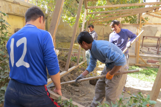 Ghulam ( second from left ) working on our community's greenhouse, together with Zek, Khamad and Ali